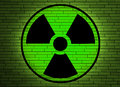 Radiation sign on a wall. Royalty Free Stock Photo