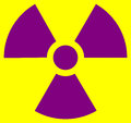 Radiation symbol standart proportions and colors yellow magenta or purple Royalty Free Stock Photo