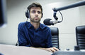 Radio anchorman hosts the program Royalty Free Stock Photo