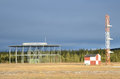 Radio beacon vor and ils glideslope ground station aviation at airport with Royalty Free Stock Photo
