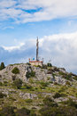 A radio communications tower on a stone hill Royalty Free Stock Photo
