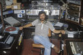 Radio disc jockey for station KFI in his studio, Los Angeles, CA Royalty Free Stock Photo