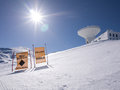 Radio telescope on a snowy peak observatory in the sierra nevada Stock Image