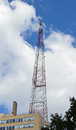 Radio tower a tall against a blue sky Royalty Free Stock Image