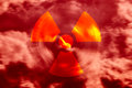 Radioactive air symbol in a red sky with clouds Royalty Free Stock Photo