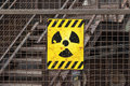 Radioactive warning sign on rusty fence Royalty Free Stock Photo