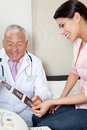 Radiologist showing ultrasound print to patient senior male female Royalty Free Stock Image