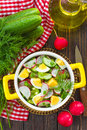 Radish salad with cucumbers and eggs Royalty Free Stock Photos