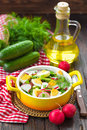 Radish salad with cucumbers and eggs Stock Photo