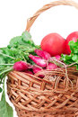 Radish tomato lettuce basket isolated on white background Stock Photo