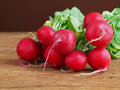 Radish on wooden background bunch of fresh radishes with green leaves Royalty Free Stock Images