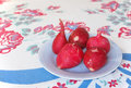 Radishes on vintage table cloth a small dish of fresh garden ready for snacking a blue dish an old floral Royalty Free Stock Photography