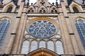 Radom holy virgin mary cathedral rosette s dominant with stained glass on the facade above the entrance in poland Stock Images