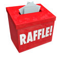 Raffle enter to win box drop your tickets dropping inside a for a or other fundraising drawing hoping big prizes or money jackpot Stock Photo