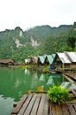 Raft houses row of with mountain behind Royalty Free Stock Images