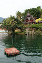 Raft and island samosir on lake toba indonesia Stock Photos