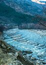 Rafting : boat moving on quiet  river section-river Beas . next to Kullu town in Himachal Pradesh Royalty Free Stock Photo