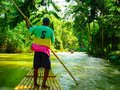 Jamaica Martha Brae River Guide on Raft Royalty Free Stock Photo