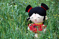 Rag baby in grass is hiding the grassland she is very lovely Royalty Free Stock Photography