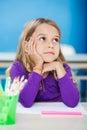 Ragazza con la mano su chin looking away in class Fotografia Stock Libera da Diritti