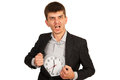 Rage business man with clock into coat holding in interior of isolated on white background Stock Images