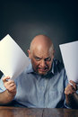 Rage expression really angry man with pieces of paper in hands Royalty Free Stock Images