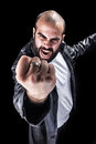 Rage a masculine bearded man isolated over a black background Stock Photography