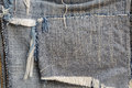 Ragged fabric of old bluejeans close up Stock Photos