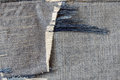 Ragged fabric of old bluejeans close up Stock Photography