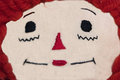 Raggedy ann doll face closeup close of dolls with red hair Stock Photos