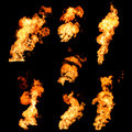 Raging fire spurts of flame texture photo set on black tongues and isolated background Stock Photo