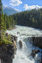 Raging river waterfall white water rapids flowing into Royalty Free Stock Image
