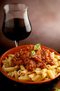 Ragu pasta and red wine Royalty Free Stock Photography