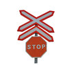 A rail crossing stop sign isolated on white background Stock Photos