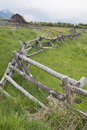 A rail fence leads into an old historic barn. Royalty Free Stock Photo