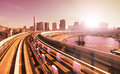 Rail track and cityscape of tokyo during sunset, view from speed train Royalty Free Stock Photo