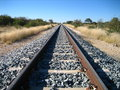 Rail track through namibian savanna Royalty Free Stock Photos