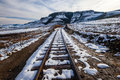Rail Tracks Snow Mountains Royalty Free Stock Photography