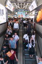 Rail travellers pass through a train station bts skytrain during rush hour on june in bangkok thailand launched in the bts now has Stock Image
