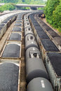 Rail Yard with Coal Hopper and Tank Railcars Royalty Free Stock Photo