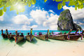 Railay beach in krabi thailand long tail boat on tropical with limestone rock Stock Photos