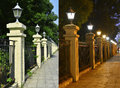 Railing with street lamps in the daytime and in the evening Royalty Free Stock Photo