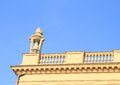 Railing yellow with statue of cup and blue sky behind Royalty Free Stock Photo