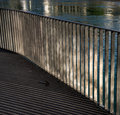Railings highlights and the reflecting surface of the bridge Royalty Free Stock Image