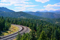 Railroad Bend Curve in the Mountains on a Sunny Day Royalty Free Stock Photo