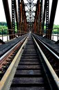 Railroad bridge perspective early morning photograph of a train crossing the mississippi river at dubuque ia Stock Photography