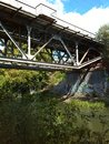Railroad bridge river grass bush green Stock Photo