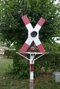 Railroad crossing without barrier, with warning sign and stop signal at an old railway line Royalty Free Stock Photo