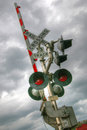 Railroad crossing lights and barricade Royalty Free Stock Photo