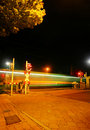 Railroad crossing at night with a Metro Royalty Free Stock Photo